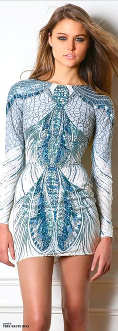 Zuhair #Murad Fall/Winter 2014 RTW. Using the combination of techniques in small design areas to create a larger image. Love that the designs on this dress flows throughout rather than just having a singular design placed individually. The details of embellishment interweaves within the other embellishments. This dress also has that bright pop of teal blue colour used.
