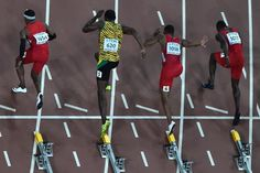 "August 23, 2015 | Bolt defeats Gatlin in 100m finals. (R-L) USA's Justin Gatlin, USA's Tyson Gay, Jamaica's Usain Bolt, USA's Mike Rodgers, USA's Trayvon Bromell prepare to compete in the final of the men's 100 metres athletics event at the 2015 IAAF World Championships at the ""Bird's Nest"" National Stadium in Beijing on August 23, 2015. AFP PHOTO / ANTONIN THUILLIER (AFP Photo/Antonin Thuillier)"