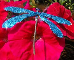 Easy Dragon Fly Children's craft.  All you need:  ~ twigs  ~ beads for the eyes  ~ maple keys  (seeds that fall from the trees.)  ~ glue gun   ~ glitter (if that appeals to you)   This would make a fun children's party craft.