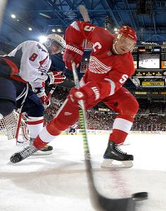 Nicklas Lidstrom keeps the puck away from Washington's Alex Ovechkin during their game at Joe Louis Arena, Oct. 10, 2009.