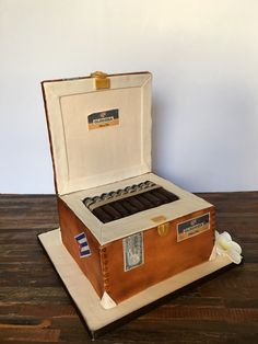 Personalized open Cohiba cigar box cake, named Gurhiba after the birthday boy.