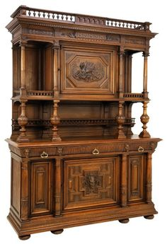 Lot:A HENRI II WALNUT BUFFET WITH CARVED DRAGON AND PAN, Lot Number:116, Starting Bid:$600, Auctioneer:Morton Auctioneers , Auction:A HENRI II WALNUT BUFFET WITH CARVED DRAGON AND PAN, Date:02:30 PM PT - Jul 25th, 2013