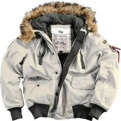 The Alpha Mountain Jacket made from Waxed Canvas is a short waist length extreme weather coat with a removable synthetic fur collar and high cold temperature rated lining. With the usual great design touches associated with Alpha Industries Pilot Clothing, Puffer Jackets, Winter Jackets, Nylons, Alpha Industries, Rain Jacket, Bomber Jacket, Aviator Jackets, Vintage Jacket
