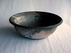 Small pit fired bowl made from stoneware clay and fired to cone 6 before being pit fired giving it the final look.