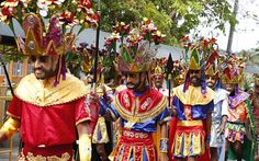 Penitents called 'Morions' parade along the streets of Mogpog town in central Philippines. During the annual festival, masked and costumed penitents called 'Moriones' dress in attire that is the local interpretation of what Roman soldiers wore during biblical times.
