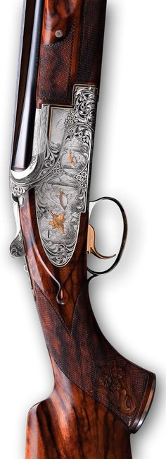 Browning Custom Sporter Side plate Trap - With a full sideplate design, the Sporter is the epitome of over and under shotguns. This much appreciated model is generally configured with long barrels and a wide ventilated rib fitted with a mid-bead sight.