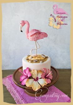 {A Gumpaste/Fondant Flamingo Cake Topper with Hibiscus}