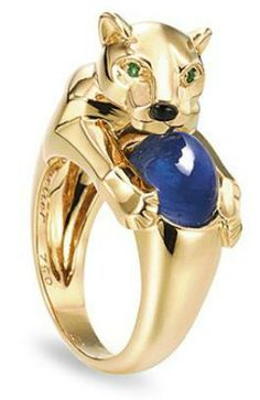 A sapphire and emerald panther ring by Cartier. The ring is shaped like a gold panther that curls around the finger, holding a cabochon sapphire. The panther has an onyx nose and emerald eyes. Via Diamonds in the Library. Cat Jewelry, Animal Jewelry, Jewelery, Bullet Jewelry, Geek Jewelry, Gothic Jewelry, Fine Jewelry, Jewelry Necklaces, Best Diamond