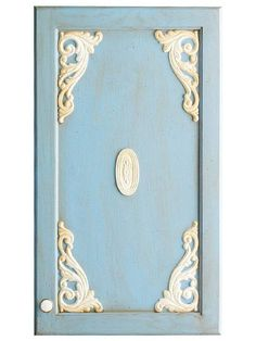 Cute Cutouts Wooden appliques (available at home centers and lumberyards) can be easily painted and attached to cabinet doors with wood glue. These simple embellishments, along with a little paint, can add cottage style to your kitchen.