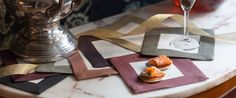 Natural linen cocktail napkins with a border in eight different colors: Gold, Rust, Burgundy, Black, Gold, Terracotta and Fig - Modern Holiday Entertaining