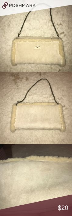 UGG Purse Hand Warmer in One!! not only is it a cute winter clutch for all your items, it will also keep your hands warm with the fur lining! In pretty decent shape! UGG Bags Clutches & Wristlets