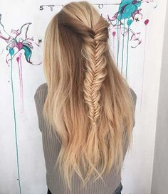 Fishtail Half Updo / #hairstyles #long  Loosely fishtail braid the top section of you hair to get this lovely half updo. You can also recreate it with a French or Dutch braid.