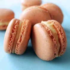 French Macarons with Mango Buttercream Filling - I need all tips I can find for macaroons and the thought of mango buttercream caught my attention.