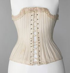 Corset (Back View) Carlson's Date: ca. 1880 Culture: probably British Medium: cotton, silk, metal, bone Dimensions: Length at CF: 13 1/2 in. (34.3 cm) Credit Line: Brooklyn Museum Costume Collection at The Metropolitan Museum of Art, Gift of the Brooklyn Museum, 2009; Gift of E. A. Meister, 1950 Accession Number: 2009.300.3108a–c