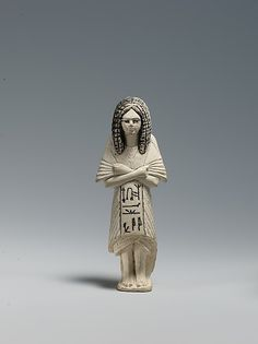 Shabti of the Scribe Huy wearing a Bat-pendant  Period: New Kingdom, Ramesside Dynasty: Dynasty 19 Date: ca. 1295–1185 B.C. Geography: Egypt Medium: Faience, Blue and yellow