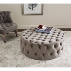 The epitome of 1930s Hollywood glamour, this luxe ottoman is sophisticated with lavish cotton velvet button tufted upholstery in mushroom.