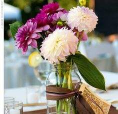 Mason Jar Centerpieces :  long stemmed flowers with a note attached for guests at each table to read.... A thank you, or story of how the couple met