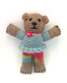 Ravelry: eLoomanator's Mother Bear #6 Belinda More girly: peplum ruffle—2 treble crochet sts in each stitch around bottom of shirt plus simple chain stitch flower with knot of neck chain pulled through centre.