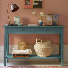 Coral-blush-pink-hallway-with-blue-console-table