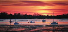 https://flic.kr/p/F1eq61 | Blazing Creek | Low tide at the creek that flows from the marina at Port Solent past Portchester Castle to Portsmouth Harbour. I was hoping to capture sunset over the castle keep but I had forgotten to click the 'today' button on the Photographer's Ephemeris and found that the sun is now setting too far to the north. As a compromise I focused on shots of the creek area, cropping in to the scene with a short telephoto lens to make the most of the intense sunset…