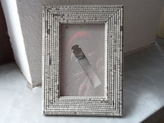 Made with newspaper rolls and glued to ordinary wood frame. SO Anthropologie-looking!