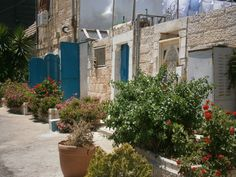 An old courtyard in the Shteibelach. The turquoise paint is a favorite in Jerusalem for its beautiful contrast against the stark white stone facing of every building, and for its powers aganst Ayin Hara. These old courtyards are protected by ancient land trusts set up long before the State of Israel.