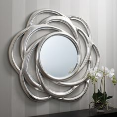 If you looking for an easy way to enhance a living space, add a little polish with a wall mirror. Hanging a mirror can do wonders for any room. www.bocadolobo.com #bocadolobo #luxuryfurniture #exclusivedesign #interiodesign #designideas #mirrorideas #mirror #themirror