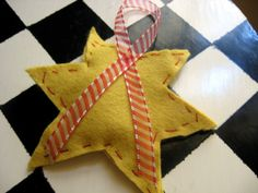 home-made car freshener with cotton balls (or dryer lint) soaked with essential oil in hand sewn shapes. Great gift idea for kids to make for adults