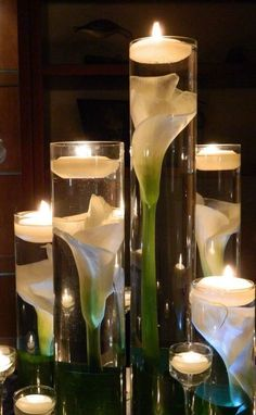 Lighted floral centerpieces with floating candles and long stemmed flowers. Check out the DIY on the blog!
