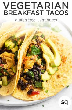 These 5 MINUTE vegetarian breakfast tacos are so delicious and easy to make! With eggs, black beans, spinach, salsa and corn tortillas, they're a fast, easy protein-packed healthy breakfast idea. Vegetarian and gluten-free too!
