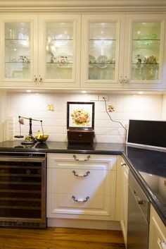 small traditional style kitchen with wine fridge and glass overhead cabinets wwwthekitchendesigncentre - Kitchen Overhead Cabinets