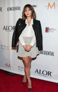 : At the LA Confidential pre-Emmys kickoff celebration in LA, Katharine McPhee tucked a white blouse into a printed miniskirt, then threw on a black leather jacket and studded pumps.