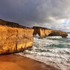 The London Bridge on a stormy Port Campbell day. The impact of the ocean on this iconic landmark is something you need to see, possibly something to add to your bucket list.