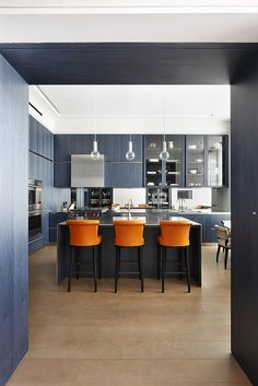 Cheyne Place by MWAI Architecture & Interiors #kitchen #kitchendesign #interiors #orange #orangechairs #modernkitchen #elegant #mwai