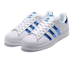 Adidas Superstar Blue Metallic Sneakers Brand new comes with box (no lid) Size 8 in women's Color: white and blue metallic detailing Addidas Sneakers, Superstars Shoes, Metallic Sneakers, Baskets, Adidas Shoes Women, Blue Adidas, Adidas Stan, Sneaker Brands, Blue Shoes