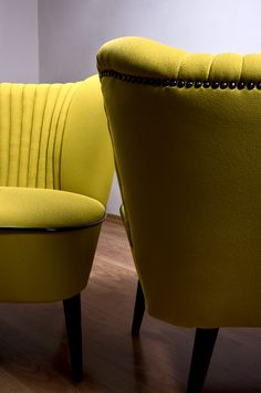 Restored classic club chair. Covered with banana-colored upholstery fabric. www.updatechair.com