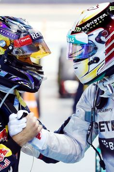 Vettel congratulates Hamilton on the victory. It's only Vettel 2nd podium of 2014.