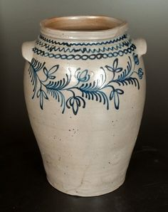 "Six-Gallon B.C. Milburn (Alexandria, VA) Stoneware  with Elaborate Cobalt Floral Decoration, Stamped ""B.C. MILBURN / ALEXA,"" Alexandria, VA origin, circa 1850, ovoid jar with tooled shoulder, squared rim, and large applied tab handles, decorated on the front with a slip-trailed vine Antique Crocks, Old Crocks, Antique Stoneware, Stoneware Crocks, Earthenware, Glazes For Pottery, Glazed Pottery, Pottery Making, Jar Storage"