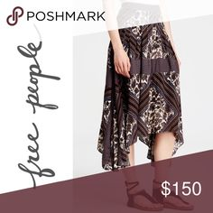 """🍂 Free People Printed Paradise Midi Skirt Neutral, earth-tones, stripes, and hand-drawn flowers define the pattern of this pleated, midi skirt. It's flowy fabric and handkerchief hem are perfect for festival season. It also has a banded waist and hidden back zipper with a hook and eye closure as well as usable pockets!  Approximately 28"""" - 36"""" long. Approximately 14"""" across the waist band, laid flat.  Model is 5'11"""" 34-24-35 and is wearing a size 2.  100% rayon  ❌ Sorry, I don't trade. Free…"""