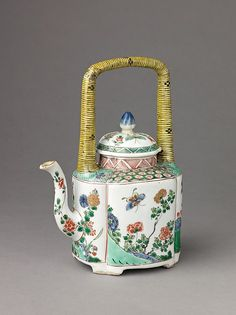 Small covered wine pot or teapot Artist: Chinese , Qing Dynasty, Kangxi period Date: 1662–1722 Culture: Chinese Medium: Porcelain painted in overglaze famille verte enamels and gilt