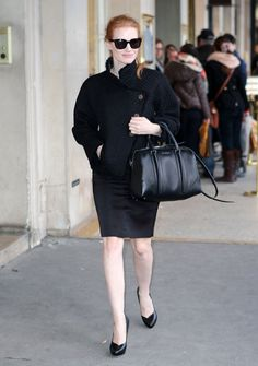 Jessica Chastain in a tweed jacket, pencil skirt, Givenchy bag, and platform pumps while strolling the streets of Paris at Paris fashion week.