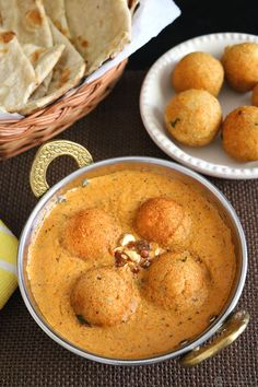 malai kofta/    	     Mashed potato - 1 1/2 Cup (* Refer notes section)     Grated paneer - 1 Cup     Red chilli powder - 1/4 tsp     Coriander powder - 1/4 tsp     Garam masala - 1/2 tsp     Corn flour - 1 1/2 Tbsp     Salt - 1/4 tsp (Adjust as per taste)     Coriander leaves - 1 Tbsp (Finely chopped)     Oil - For deep frying  For Gravy      Oil - 1 tsp + 3 Tbsp     Onion - 1 Large (Cubed)     Garlic - 2 Cloves     Ginger - 1/4 inch     Tomato - 2 Large (Cubed)     Bay leaf - 1…