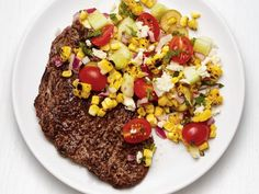 Get Grilled Steak with Greek Corn Salad Recipe from Food Network
