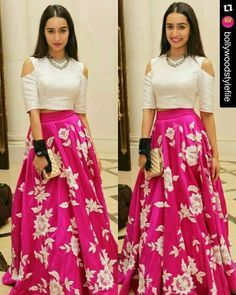 Silk crop top and hot pink skirt with thread embroidery all over.This is a custom stitch.