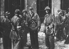 Soldiers of Group 'Radosław' after moving through the sewers from Stare Miasto.