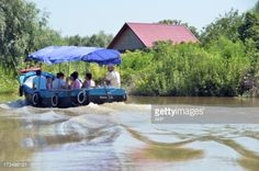 02-05 A boat with tourists motors in the small city of Vylkove,... #vylkove: 02-05 A boat with tourists motors in the small city… #vylkove
