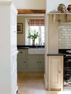 Love the subtle textures and color. Extremely expensive takeoff on an 18th century kitchen idea.