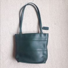 """Vintage Coach Tribeca Bucket Shoulder Bag #9098 Coach Tribeca Bucket Tote Style #9098 -  Dark Green all Leather                                                          In great condition with no rips stains or tears. Minimal scratches to leather from normal wear can be seen, but most are small and most are on back side of bag. Comes with hang tag. Approx Dimensions: 9.5"""" H x 11"""" W x 5"""" D, strap drop : 11.5"""" Coach Bags Shoulder Bags"""