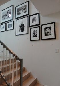 Staircase photo wall idea. I don't have  a staircase but I like the black frames with white matting.