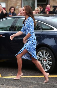 The Duchess of Cambridge ditched her usual demure style today as she flashed her legs in a £1,728 blue patterned dress by New York-base designer Altuzarra